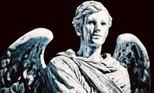 Close-up Of Angel Statue Against Black Background