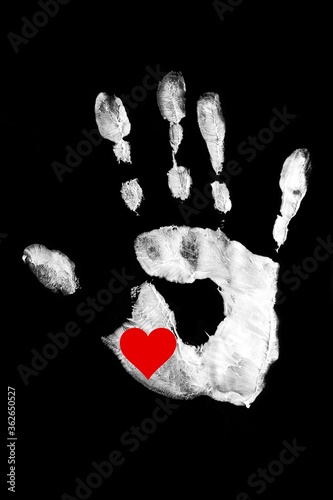 Tablou Canvas White handprint with red heart on a black background