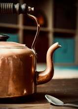 Old Copper Kettle On Wood