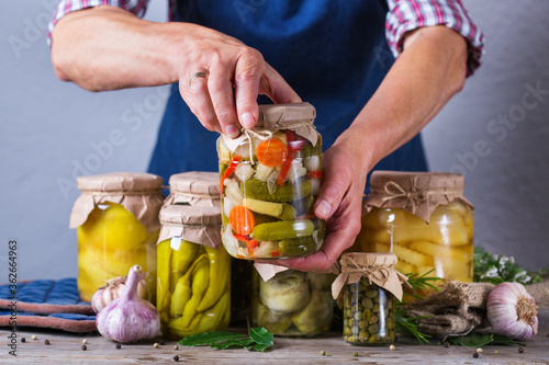 Fotografering Homemade preserved and fermented food, pickled and marinated vegetables
