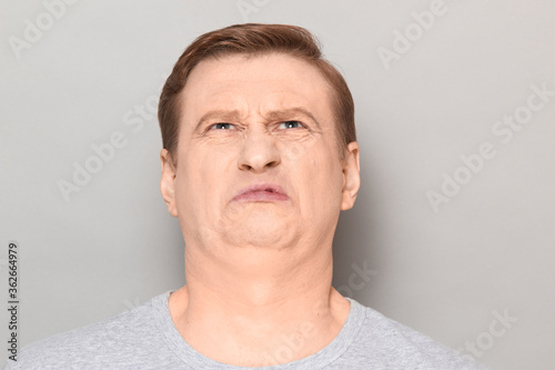 Portrait of funny man grimacing from disgust and squeamishness Tablou Canvas