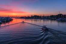 Sailboats Moored In River Agai...