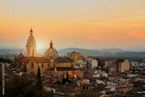 High Angle View Of Buildings In City At Sunset Fotobehang