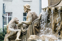 Statue By Fountain Against Building