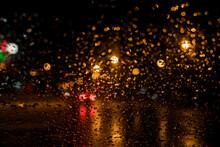 Illuminated Light Seen Through Window During Rainy Season