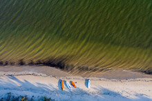 Brazil, Florianopolis. Panoramic Aerial View Of Daniela Beach Pontal Peninsula And River With Colorful Small Boats On The Sand Shore.