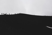 ETNA NATIONAL PARK, SICILY, ITALY Row Of Tourists Walking On The Edge Of A Crater An Altitude Of 2900 M., At The Border With The Area Of High Criticality Of The Volcano.
