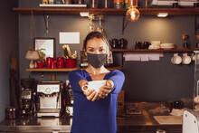 Caucasian Woman Offering Coffe...