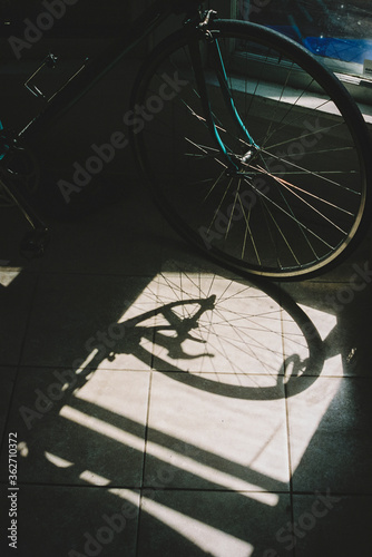 Bike leans against wall in bright room