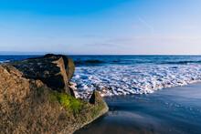 Ocean Waves Breaking Over Rocks