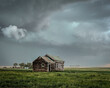 Abandoned farmstead structures on the Great Plains with Dramatic Skies Overhead