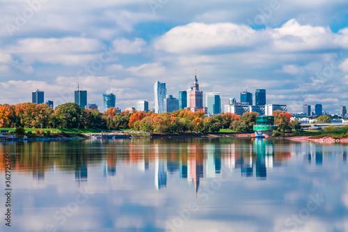 Fotografie, Obraz Reflection Of Buildings In Lake Against Sky