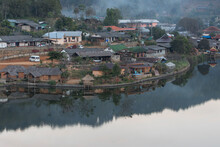 High Angle View Of Townscape By Lake