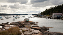 Stonington, Maine;  A  Cloudy Day At Stonington Bay, With Boats Anchored In The Harbor.