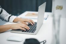 Female Hands Using Laptop Comp...