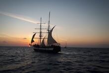 Sailboat Sailing On Sea Agains...
