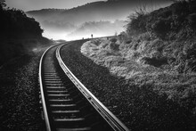 Railroad Tracks By Mountain