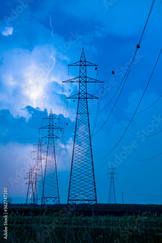 High voltage power lines with aamazing lightning Fototapeta