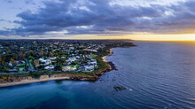 Aerial View Of Sea And Buildings Against Sky During Sunset