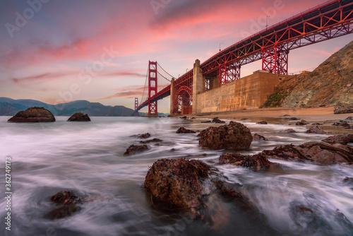 Leinwand Poster Long Exposure Capture Of The Golden Gate Bridge At Sunset On Marshall's Beach