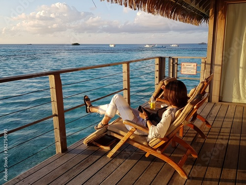Canvastavla Side View Of Mid Adult Woman Looking At Sea While Sitting On Deck Chair In Boat