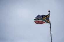 Low Angle View Of Upside Down South African Flag Against Sky