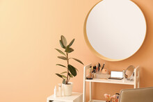 Rack With Decorative Cosmetics And Mirror In Modern Makeup Room