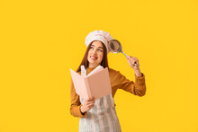 Young Woman With Recipe Book O...