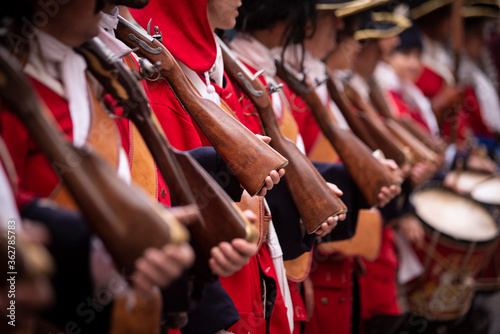 Midsection Of People With Rifles Standing Outdoors Fototapete
