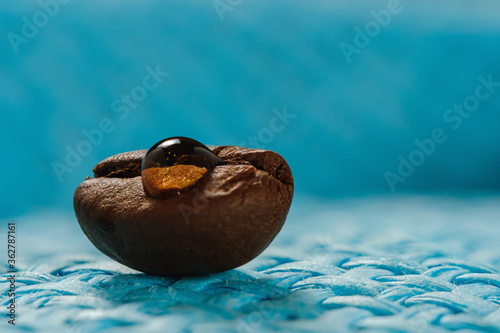 shiny fresh roasted coffee macro beans on woven background #362787161