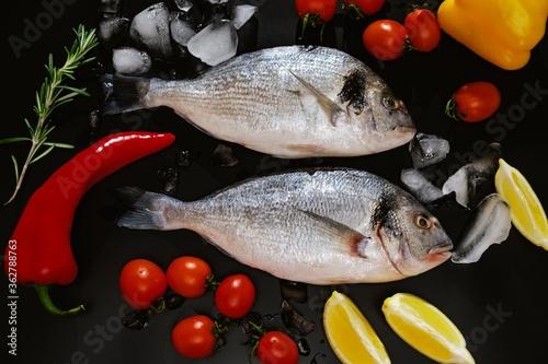 Fish seafood dorado, raw food on black background, cooking. #362788763