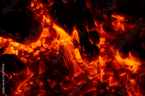 Hellfire and embers on a black background Canvas Print