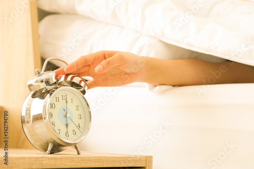 Hand reaching lazily to turn off the alarm clock at 6 am Canvas Print
