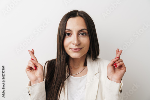 Photo of young businesswoman posing with fingers crossed for good luck Poster Mural XXL