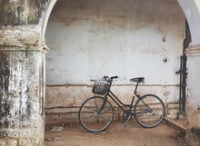 Bicycle Against Wall In Old Building