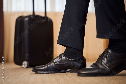 Man on business trip in hotel room Canvas Print