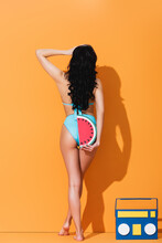 Back View Of Woman In Swimsuit...