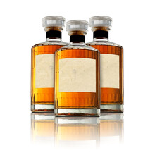 3 Full Whisky Bottle Isolated On White Background With Reflection