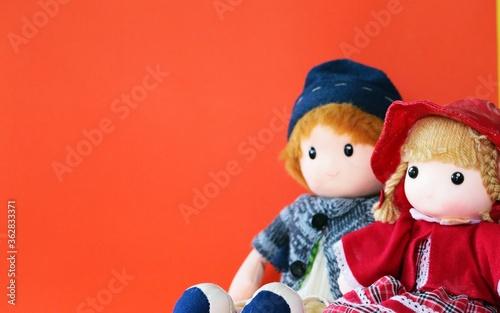 Fototapeta Close-up Of Dolls Against Orange Background
