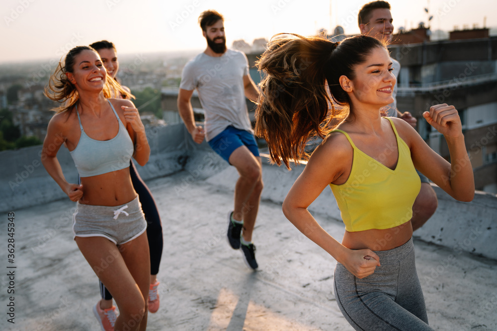 Fototapeta Portrait of smiling fit happy people doing power fitness exercise