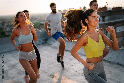 Portrait of smiling fit happy people doing power fitness exercise