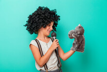 Child Comedian Performing With...