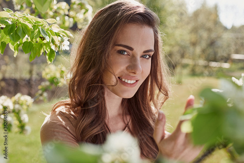 Happy beautiful woman looking at the camera outdoors