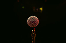 Close-up Of Microphone Against Black Background