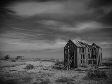 Derelict Fisherman's Shed, Dungeness Beach, Kent, Uk. Shot In Black And White.