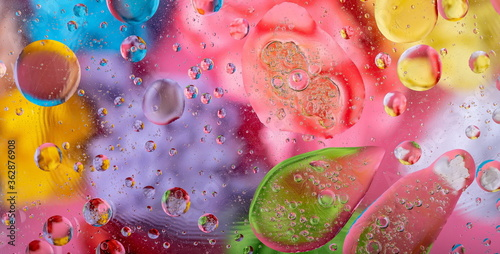 Valokuvatapetti Modern abstract liquid background with water drops and colorful glass