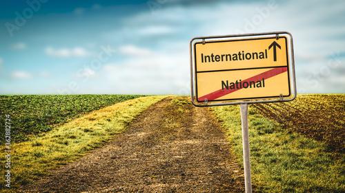 Fotografie, Obraz Street Sign to International versus National