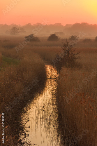 Photo Scenic View Of Land Against Sky During Sunset