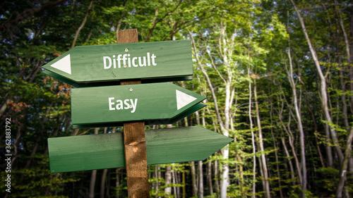 Fotografie, Obraz Street Sign to Easy versus Difficult