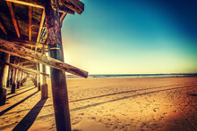 Wooden Pier And Golden Sand In...